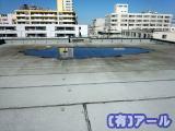 北区のビルの屋上の排水つまり